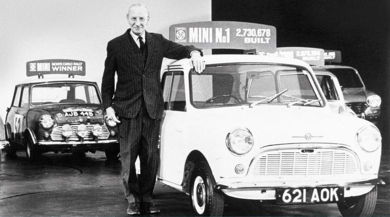 Designer Sir Alec Issigonis at his retirement party in 1971, standing  next to the first ever Morris Mini-Minor.