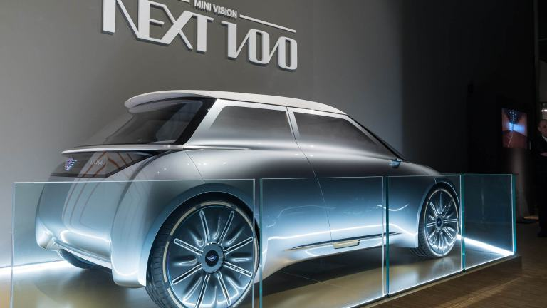The back of the sleek, futuristic, MINI Vision Next 100 model prototype in blue silver.