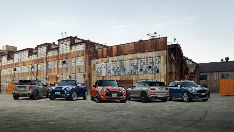 The latest MINI model line-up in an urban environment.