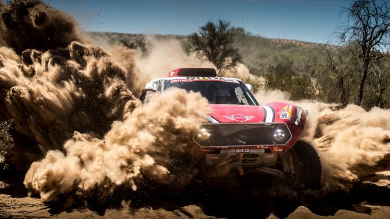 Frontal shot of MINI John Cooper Works Buggy driving through the sand dunes at Dakar Rally 2018.