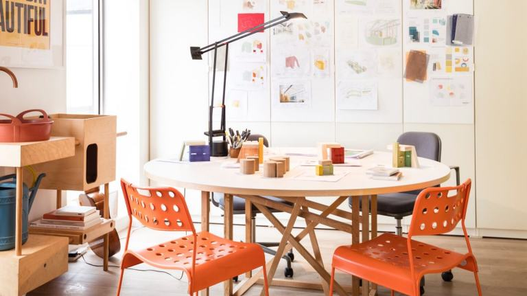 Bright, colourful workspace featuring building blocks and a full pinboard.