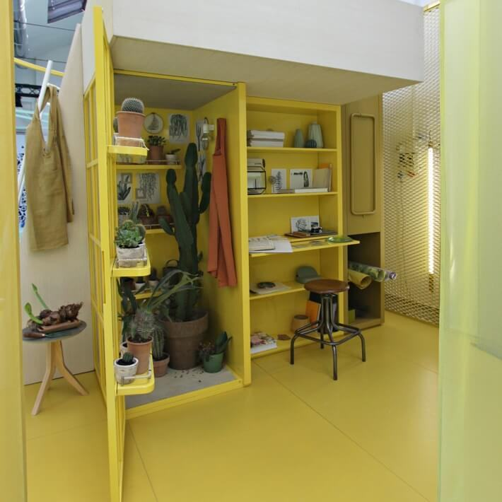 Minimal bedroom in yellow with loft bed as well as wardrobe and desk space underneath