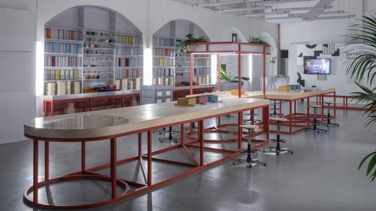 MINI's FACTORY OF IDEAS featuring long tables, stools, building blocks and other design materials