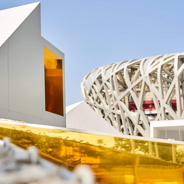 Roof of MINI LIVING Urban Cabin and view of Beijing's iconic Bird's Nest stadium.