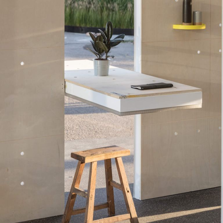 Rotating wall panel that doubles up as a work and dining table in the MINI LIVING Urban Cabin.
